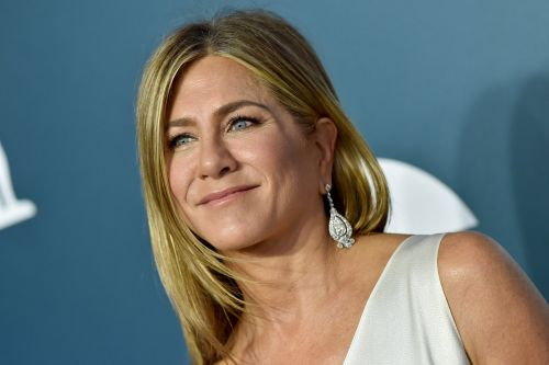 "Jen Aniston's Emmys Prep Includes Champagne and Her ""Other Mask"": A Sheet Mask"